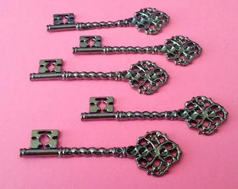 5 Large Gunmetal Filigree Key Charms