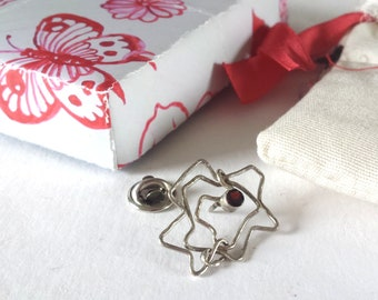 Rose brooch, silver pin brooch My rose is a rose is a rose, Petite silver 925 flower with a little robin gemstone, Dutch design Netherlands