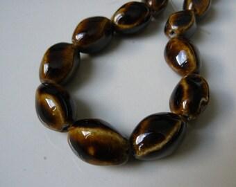 Set of 4 novelty Brown 20mm porcelain beads
