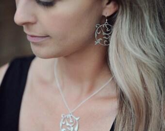 light weight earrings. jewelry accessories. pierced earrings. sterling silver earring hooks. stainless steel jewelry. modern jewelry.