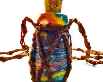Mini Rainbow Millefiori Bottle in a Crochet Harness