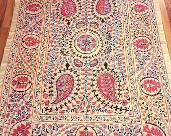 A silk on silk Uzbek suzani handmade.Wall hanging,tablecloth, bedspread.