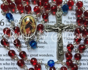 Ruby Czech glass and Capri blue Swarovski crystal round bead rosary with silver plated Our Lady Untier of Knots center and crucifix
