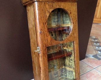 Upcycled Antique Clock Case into Curiosity Cabinet, Lined with vintage book pages