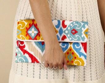 ikat foldover clutch, multicolored, multicolor, red, yellow, blue, orange, zipper clutch, de almeida designs
