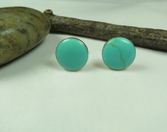 Turquoise stud earrings set in sterling silver 7 or 9 mm in diameter