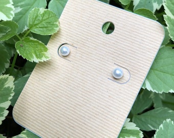 Pearl colored earring studs