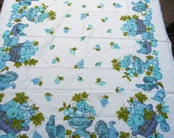 1960 Turquoise harvest tablecloth - turkeys, hens, rooster, grapes, pears, apples, baskets of fruit