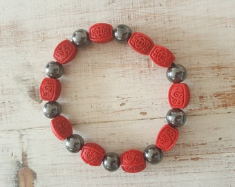 carved red cinnabar beads and hematite
