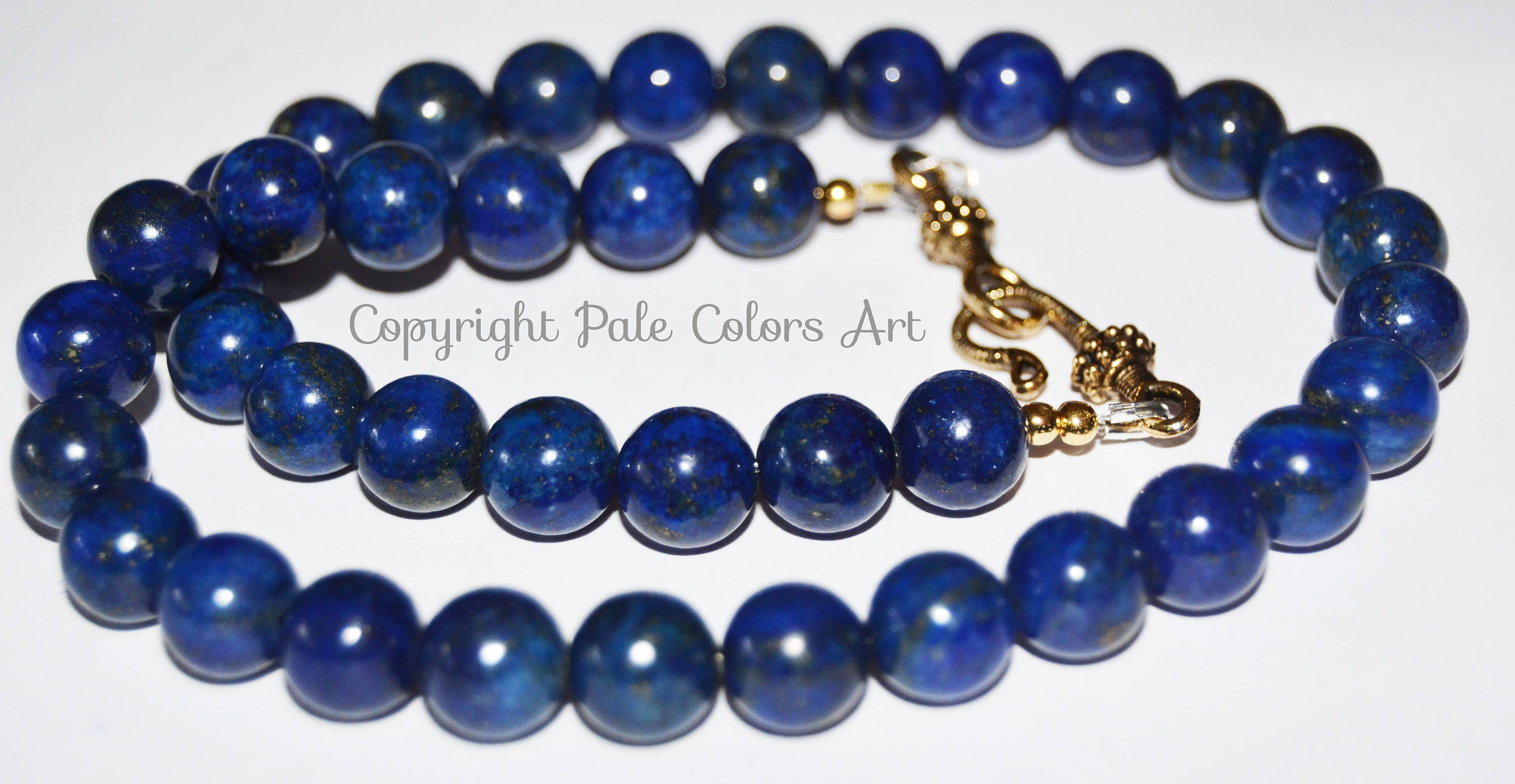 navy dark gemstone a blue design stone set like bow in index