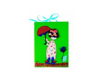 Little girl with umbrella green