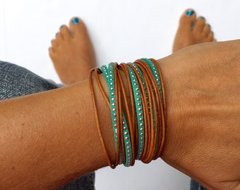 Turquoise bracelet triple wrap with silver accents. lobster clasp with heart drop and camel brown leather. Bohemian jewlery