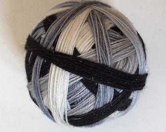 Sock yarn: 'Colourblind'  (4 colours, self striping, silver stellina)
