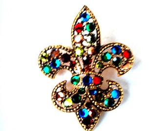 Edwardian  style,vintage 50s, gold tone metal with a multicolor rhinestones,Fleur de Lis brooch. Made by Weiss.