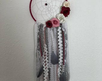 Rose colored floral dream catcher bohemian style with ribbon and feathers