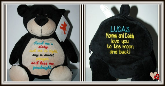 Bear, Teddy, Read me a story, tuck me in tight embroidered on a soft and cuddly black bear.