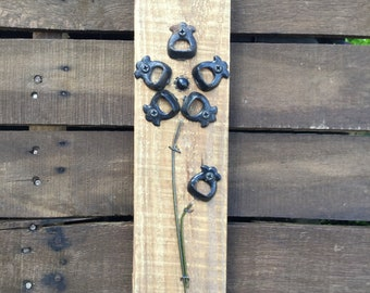 Vintage Latches made into Flowers on Reclaimed Wood