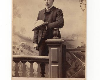 Holding hat, antique cabinet card photo