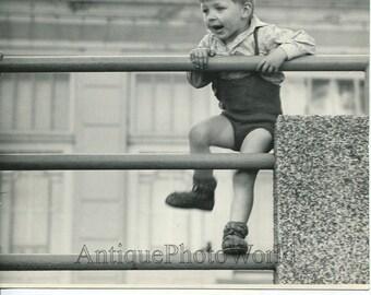 Cute boy climbing fence vintage art photo by Bohumil Straka Czech Republic