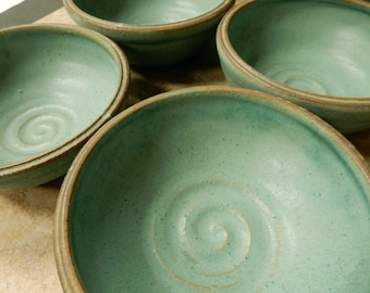 4 turquoise stoneware shallow bowls with a rustic brown rim….*