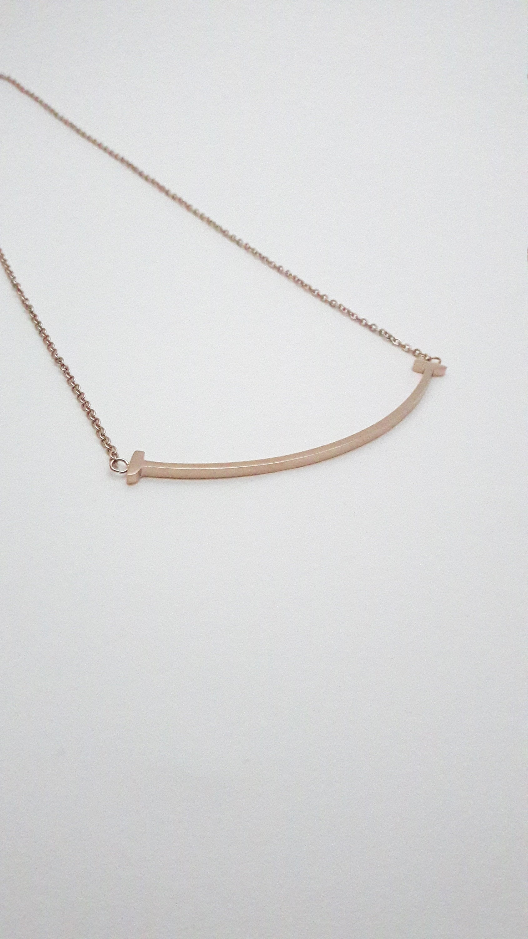 Rose Gold plated Curved Bar Smile Necklace on stainless steel