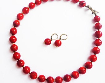 Beads and earrings with the coral