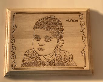 Portrait engraved in 3D on wood.