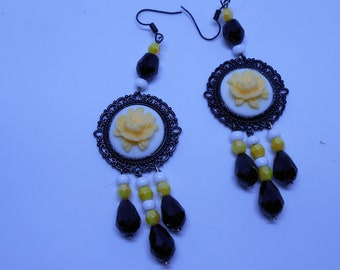 round earrings black white and pale yellow.