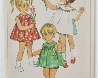 Girl's Dress Gathered To Yoke Slightly Lowered Round Neckline Back Zipper Toddler Size 1 Used Vintage Sewing Pattern Simplicity 6995