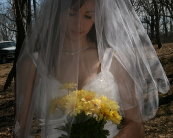 Two-tiered elbow length veil with scalloped edge