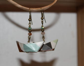 Earring origami boats.
