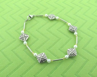 stainless steel , pewter and glass pearl anklet. avail in 9.5 and 10.5 inches