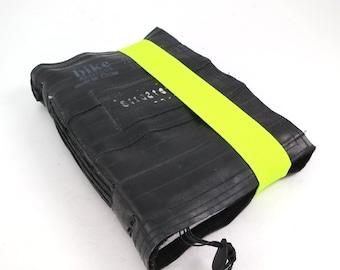 Journal, recycled bicycle inner tube, handmade blank, medium. Elastic neon yellow closure.