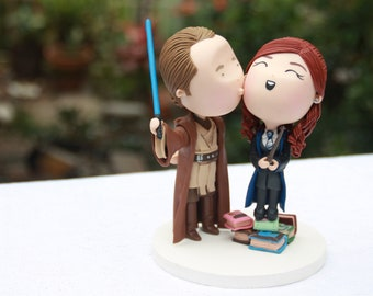 Groom kissing bride on the cheek. Jedi and Witch. Theme Wedding Star Wars/Harry Potter. Wedding cake topper. Handmade.