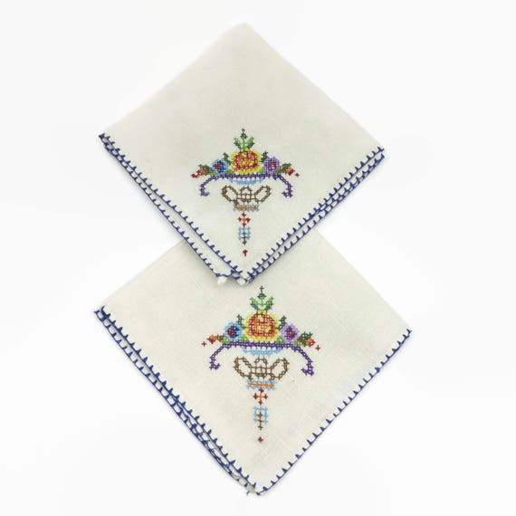 2 vintage embroidered napkins, white luncheon size with cross stitched flowers in one corner, circa mid 20th century, 10.5 inches square
