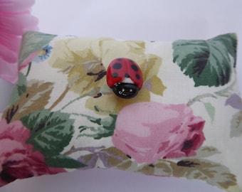 Handmade floral ladybird pincushion