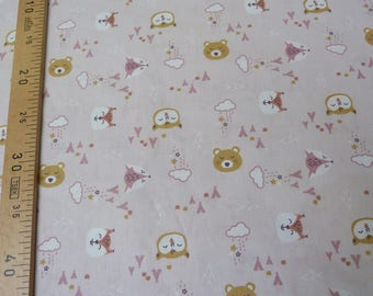 Pink printed cotton with naive patterns animals
