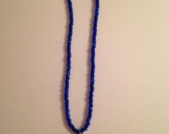 Blue beaded necklace with millefiori pendant