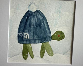 Original watercolor painting, turtle in snow, children's art, nursery art, whimsical, north face hat, square matted art, blue and green