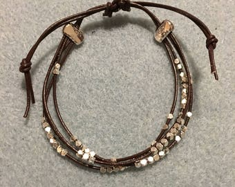 Adjustable, leather bracelet with silver beads