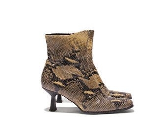 Carvella snakeprint leather ankle boots