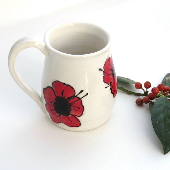 Coffee Mug with Hand Painted Poppies on both sides Hand thrown on the potters wheel each one of a kind mug holds approx. 8-10 oz.