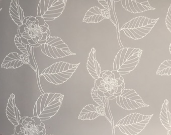 Wallpaper- Camelia self adhesive removeable wallpaper in warm pale grey with pale white flowers.