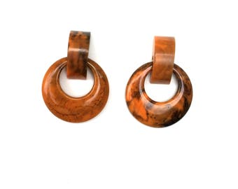 "vintage reproduction of doorknocker bakelite earrings - made from ""fab-a-lite"" resin"