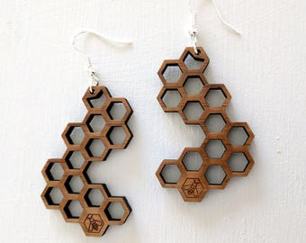 Honeycomb earrings, laser cut from bamboo, with a little bee