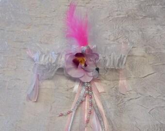 Pink and white bridal garter
