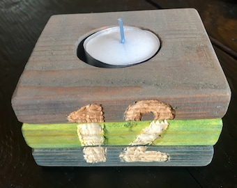 Seahawk colored candle holder.