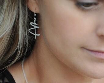 stainless steel earrings. jewelry. pierced earrings. jewelry accessories. fashion earrings. sterling silver ear hooks. dangle earrings