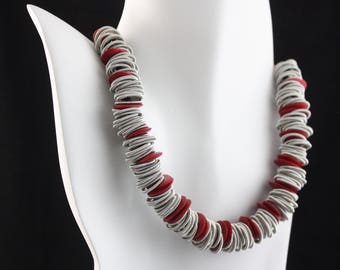 Piano wire necklace with red ceramic
