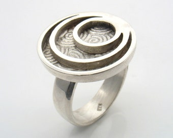 Three silver circles resting on a spiral pattern round surface. Statement Sterling Silver Ring,Cocktail Ring, Handmade Jewelry.